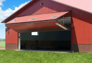 Prefab steel agricultural building with bifold door for equipment storage