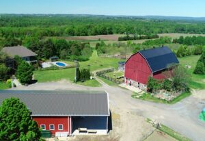 Custom designed prefab steel agricultural building with overhang porch and residential area
