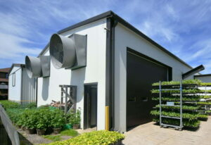 Prefab steel framed farm building with climate control for crops