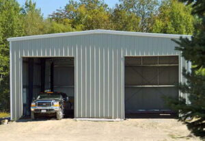 Exterior of a a pre engineered steel workshop and garage and storage building with double garage doors