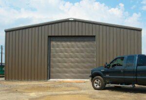A pre engineered steel workshop and garagebuilding and storage building with single steel garage door for equipment storage