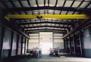 Interior of an industrial steel prefab building with crane