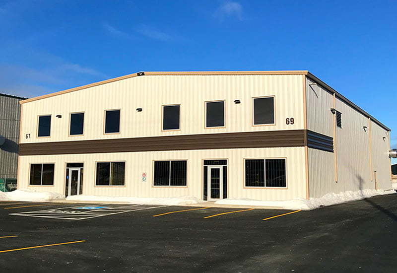 Exterior of prefab steel office building with 2 entrances and second floor mezzanine