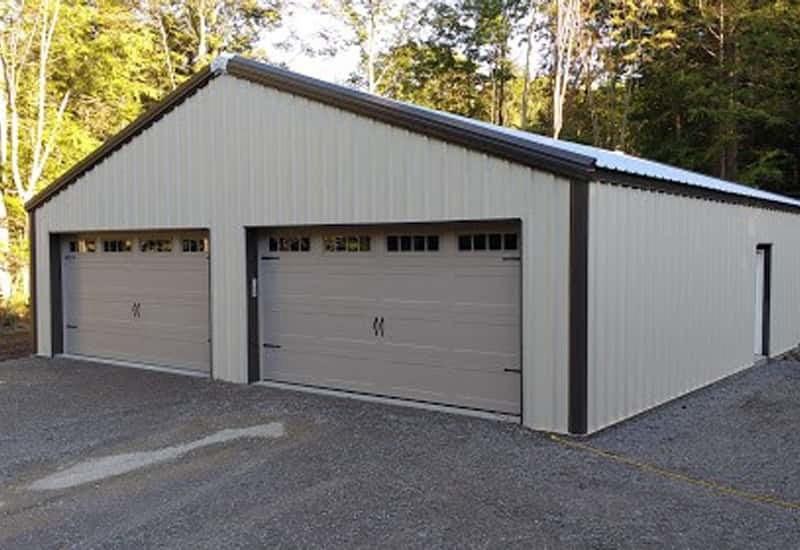 A white prefab steel building residential garage