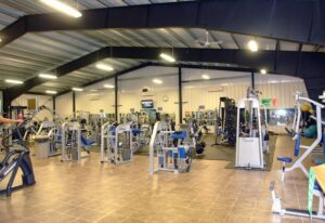 Interior image of a prefab steel building used as a gym facility