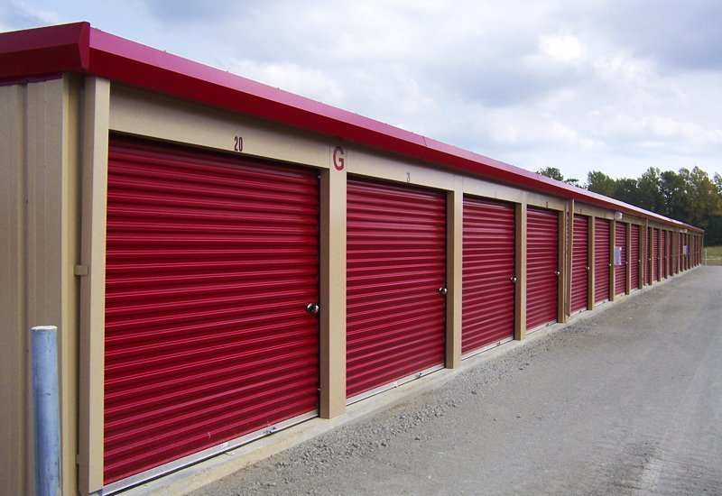 Long view of red colored steel storage units