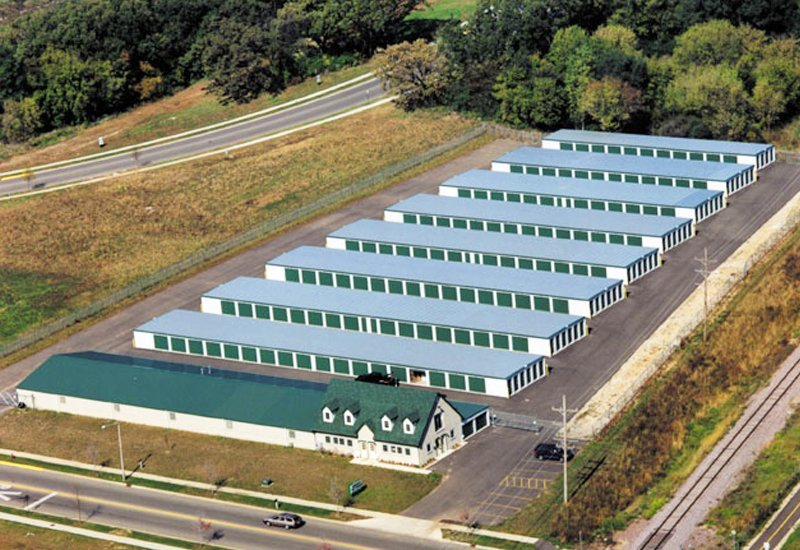 Aerial view of a prefab steel mini storage building complex with green steel doors